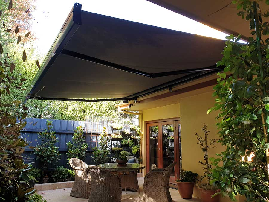 image of a folding arm awning